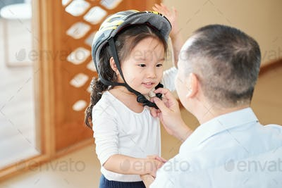 Asking father to take off bicycle helmet