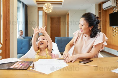Laughing mother looking at daughter