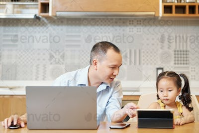 Dad and daughter with gadgets