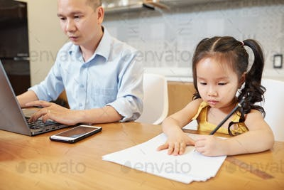 Drawing girl sitting near father