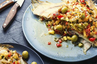 Flounder with vegetables on table