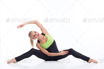 Gorgeous young woman practicing yoga sitting on the floor