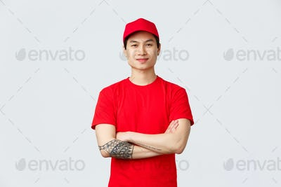 Express delivery, shipping and logistics concept. Confident asian man working in deliver company