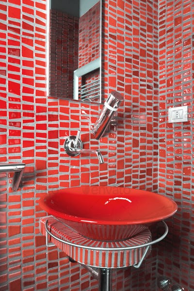 Close_Up of a Red Washbasin in the Modern Bathroom Interior