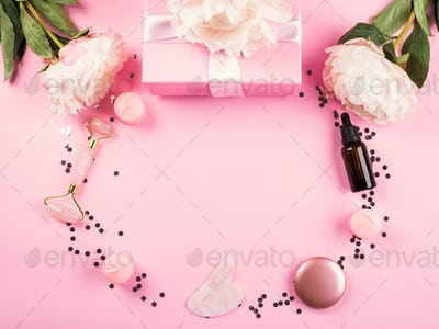 Pink beauty tools background with flowers