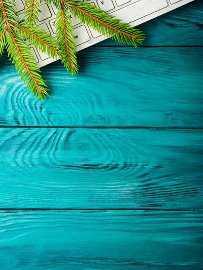 Christmas winter green background with keyboard
