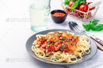 Puttanesca pasta with shrimps, horizontal, copy space