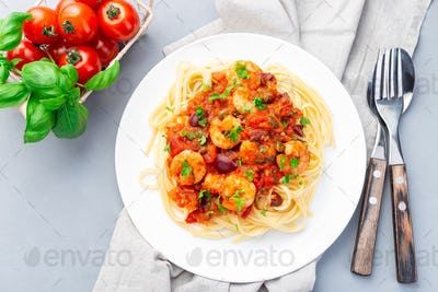 Puttanesca pasta with shrimps, horizontal top view