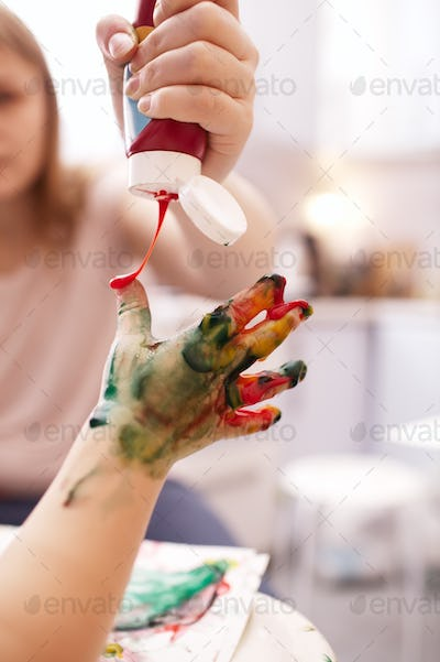 Young child playing with finger paints