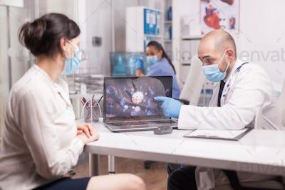 Doctor explaining covid 19 symptoms