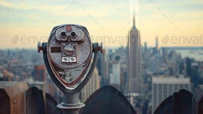 Observation binoculars in a tourist location