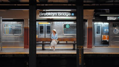 Young girl waiting for a train in the subway in New York City
