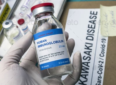 Nurse hold human immunoglobulin vial generic drug to treat Sars-CoV-2-related Kawasaki disease