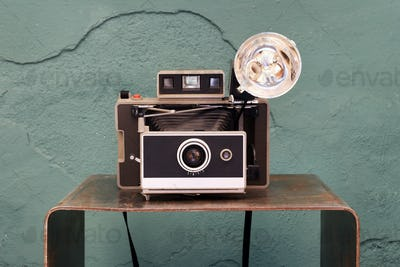 Old vintage instant camera with bellows