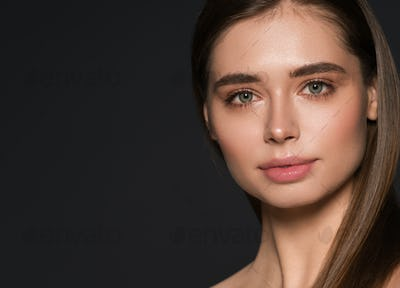 Woman beauty natural make up healthy skin and hair dark background