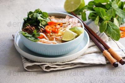 Bun Bo Hue, Bun Bo, Vietnamese beef noodle soup spicy. bowl of beef and rice vermicelli soup