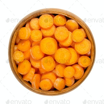 Small carrot slices, snack carrots cut into discs, in wooden bowl