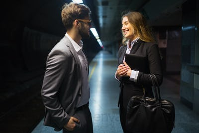 Business colleagues talking at metro station