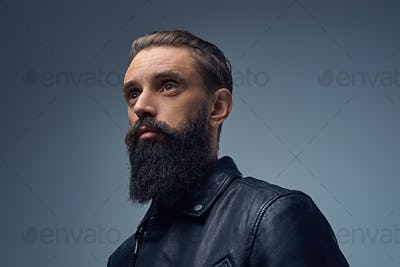 Bearded male dressed in black leather jacket.