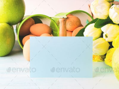 Happy Easter pastel green yellow background eggs tulips card