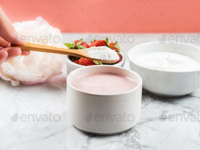 Collagen protein powder in bowl on marble