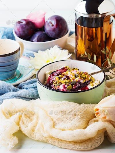 Breakfast with bowl of fresh quark, berries, seeds