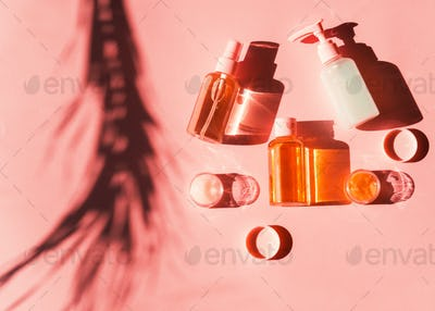 Various cosmetic products on pink coral. Flat lay