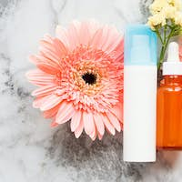 Face cream and serum in glass bottle. Skin care