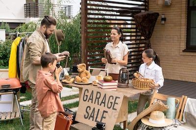 Choosing goods at garage sale