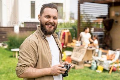 Bearded photographer at garage sale