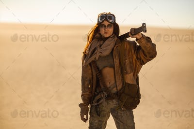 Armed Post-apocalyptic Woman Outdoors in a Wasteland