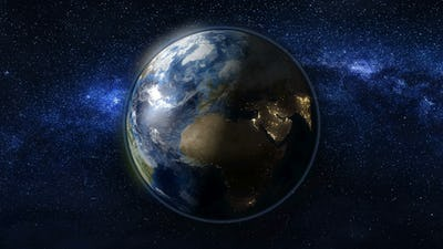 Planet Earth in black and blue Universe of stars