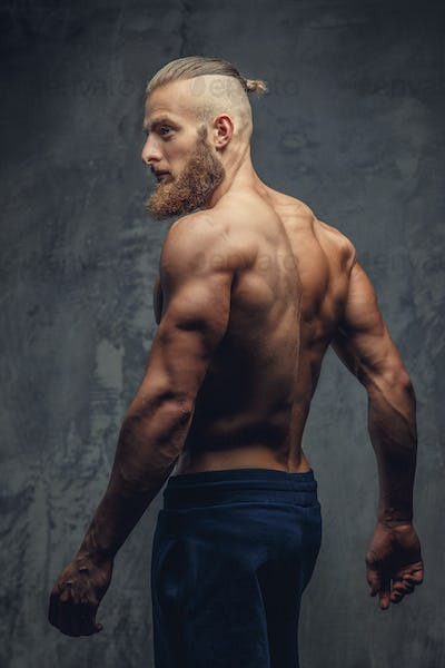 Shirtless muscular guy from back
