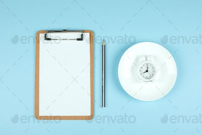 Intermittent fasting, ketogenic, diet concept. Empty plate, alarm clock, note. Flat lay, mockup