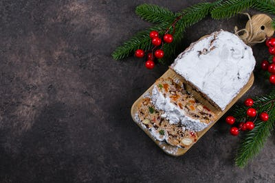 Christmas stollen. Traditional Christmas pastry dessert with festive decoration
