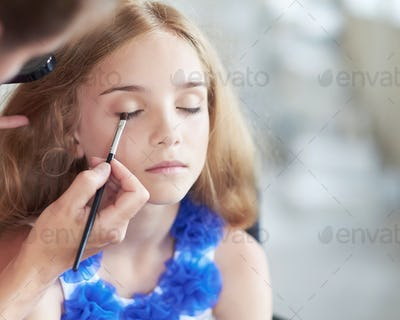 Blond female make up in saloon.