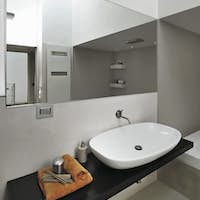 Close-Up on the Countertop Washbasin and Large Mirror  in the Modern Bathroom