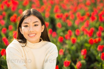 Portrait of asian girl smiling and looking at camera