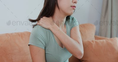 Woman tired with shoulder pain