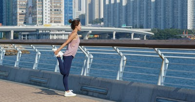 Woman stretch legs before running at outdoor