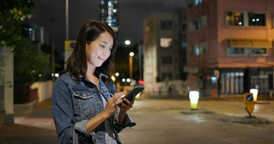 Asian woman use of mobile phone at outdoor