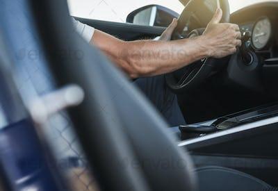 Car Dealership Client Testing Brand New Vehicle Interior