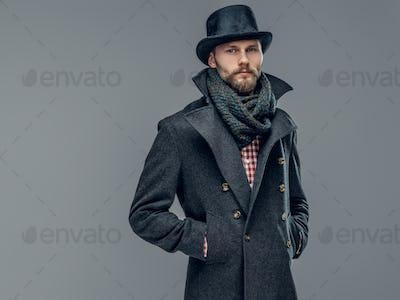 A man in a grey cylinder hat.