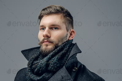 A man dressed in a jacket and scarf.