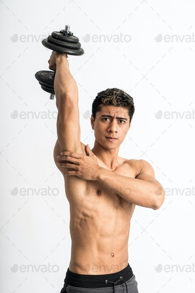 asian muscle man lift dumbbell weights with energy in the triceps