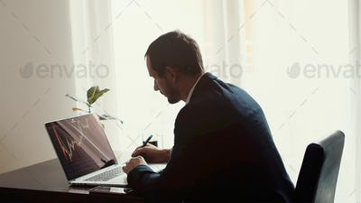 investment stockbroker stock market analysis pensive and concentrated look