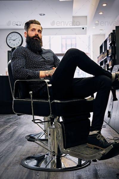 A man in hairdresser's salon.