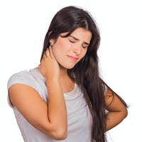Young woman with neck pain.
