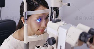 Woman check on eye