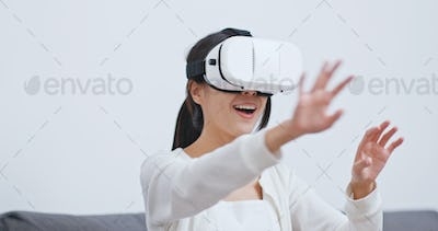 Woman play with VR device at home